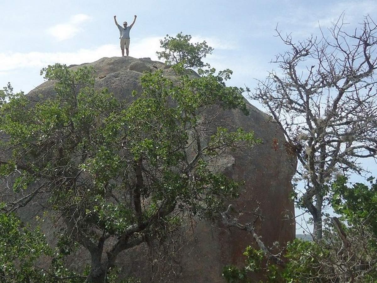 Ian confidently stands atop a smaller rock